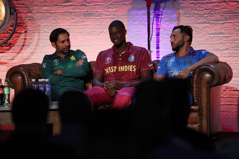 Jason Holder sits with other CWC captains.jpg
