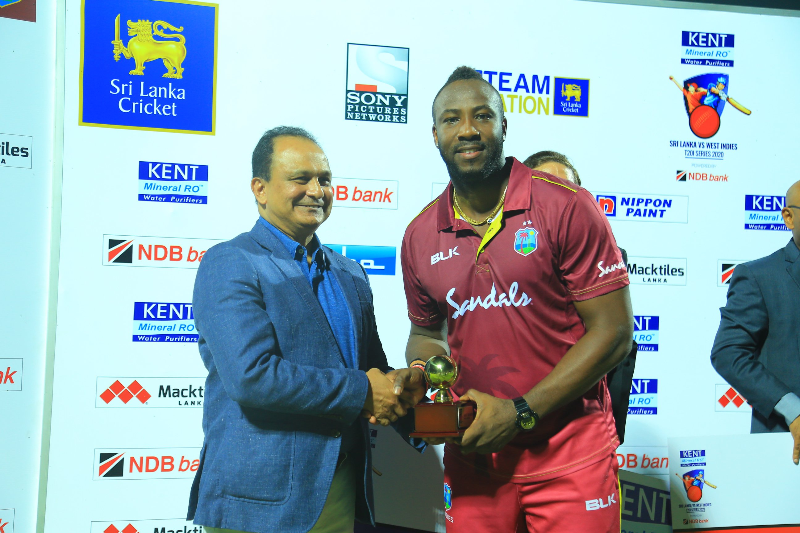 Andre Russell Receives award.jpeg
