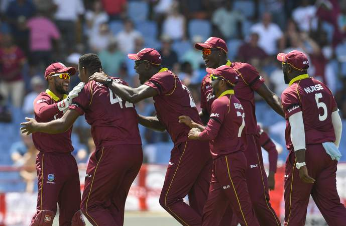 Men in Maroon celebrate ODI win.jpg