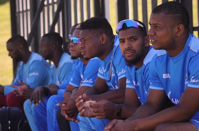 Nicholas Pooran with his West Indies brothers.jpg