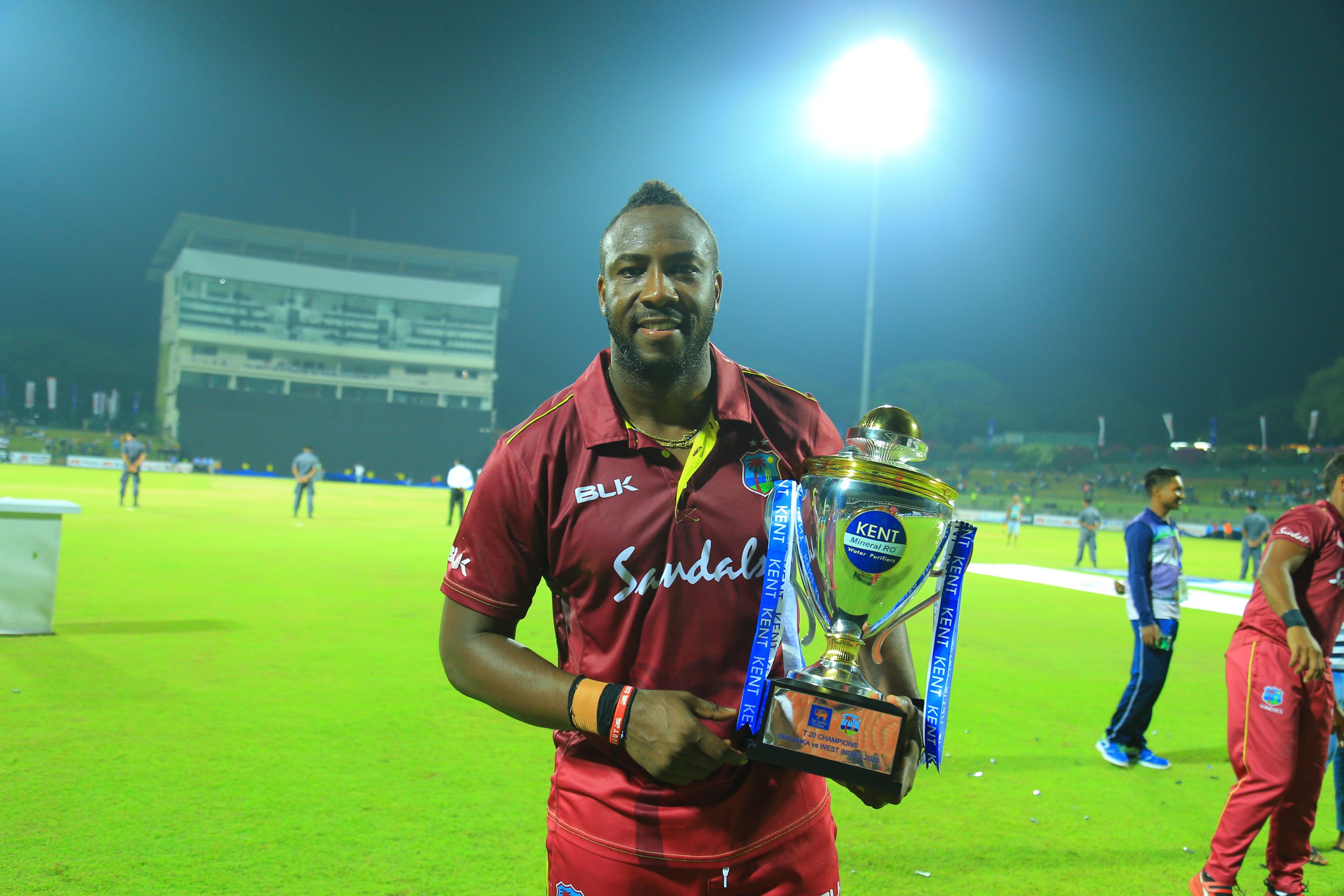 Andre Russell with Sri Lanks Trophy 2020.jpeg