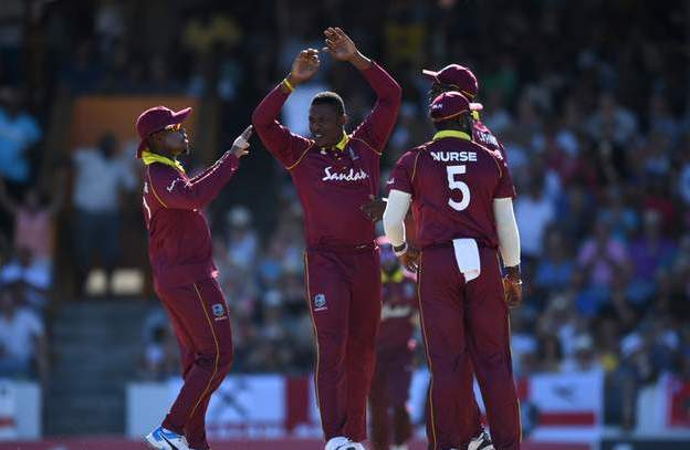 WI celebrate wicket.jpg