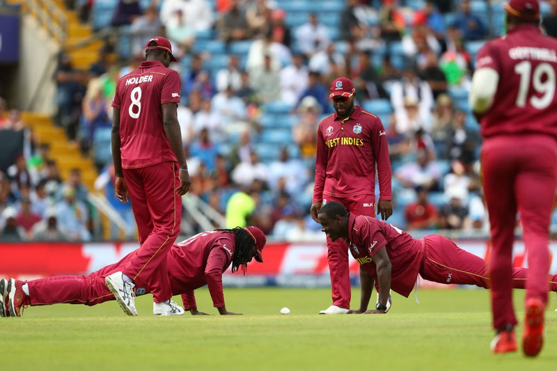 Brathwaite and Gayle takes wicket.jpg