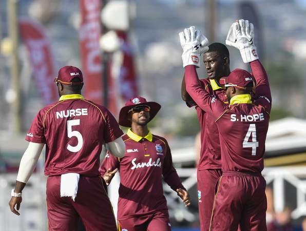 WINDIES HIGH FIVE DURING ODI.jpg