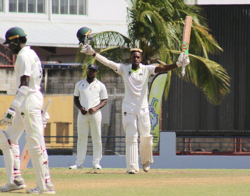 13 Keron Cottoy celebrates his maiden hundred.jpg