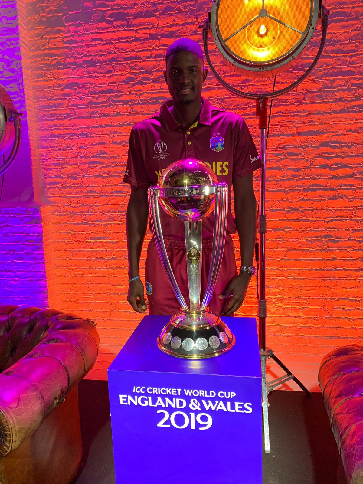 Holder with CWC trophy.jpg