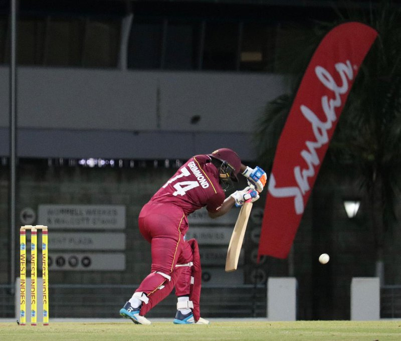 Grimmond at the crease.jpg