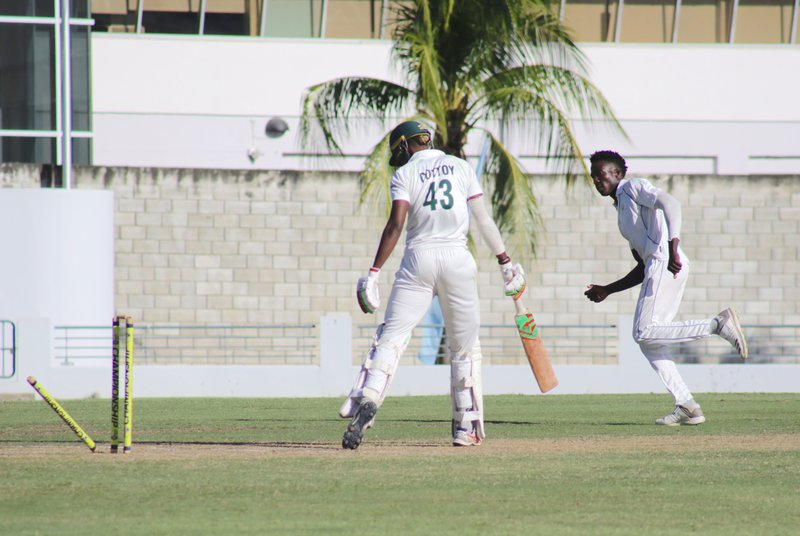 8 Keron Cottoy bowled by Chemar Holder.jpg