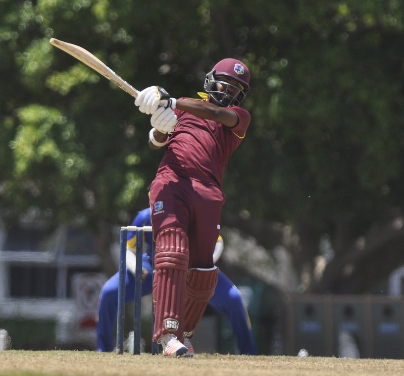 Darren Bravo plays a lofted drive.JPG