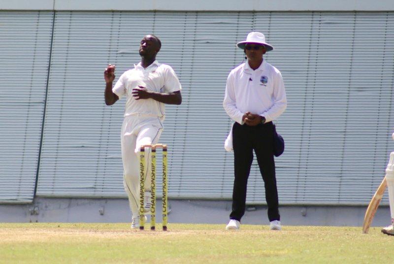 1 Kemar Roach prepares to bowl under the eye of umpire Ryan Banwarie.jpg